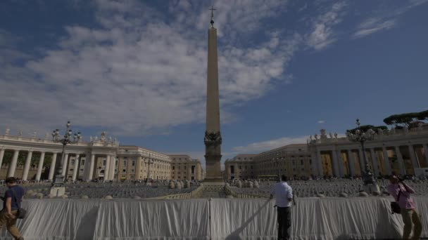 Tourists walking in Saint Peters Square, Vatican