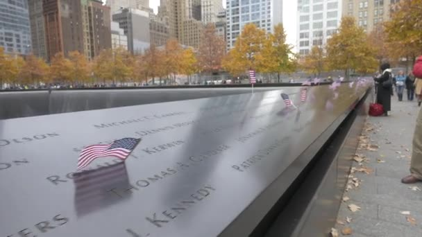 US flags on the panel at 9/11 memorial in New York, USA