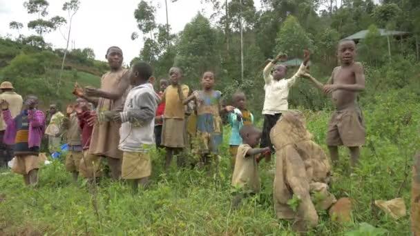Children singing and dancing in Uganda