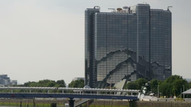 A bridge and a building with a glass facade