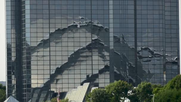 A building reflection in a glass facade