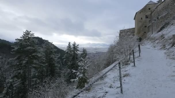 Path leading to Rasnov Citadel on a winter day