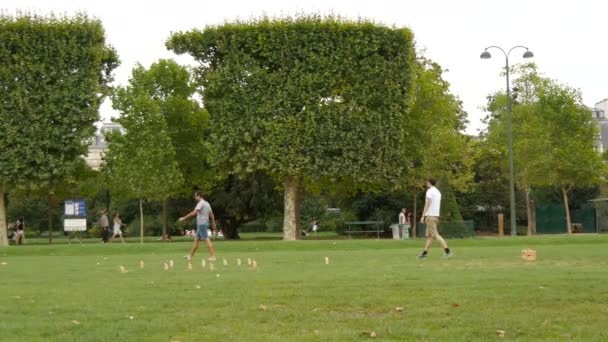 Two young men playing a game in a park