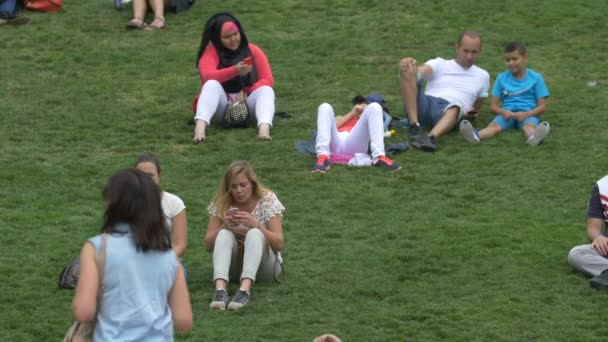 People lying on the grass