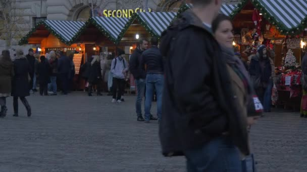 Walking by row of stalls at a Christmas Market