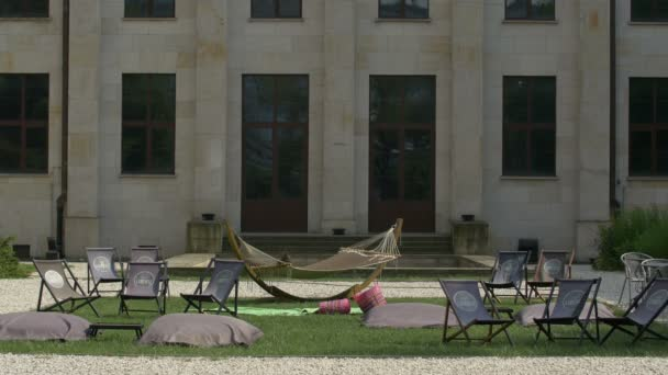 Hammock and summer lounge chairs in courtyard