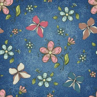 Denim background with ornate floral pattern