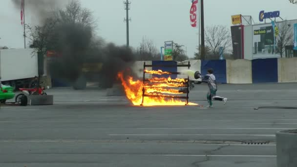 ATV driving through fire wall