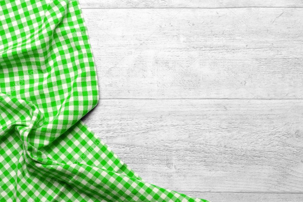 Green Checkered Tablecloth With A Wooden Background U2014 Stock Photo #74926431