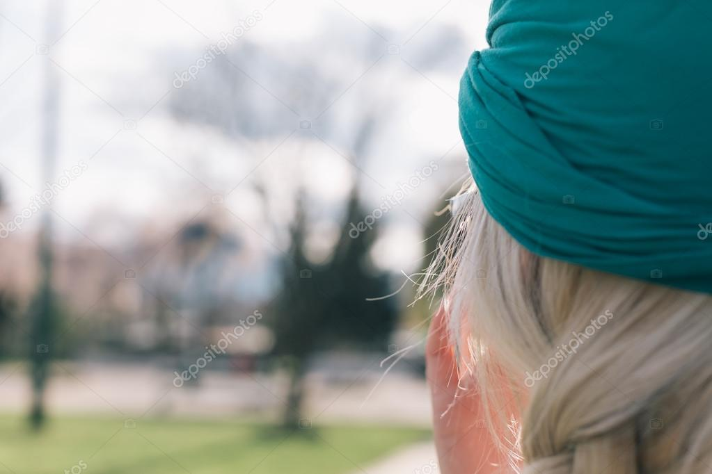 Beautiful young girl posing on pier with turban