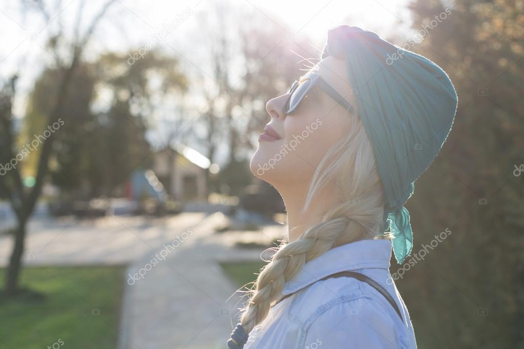 Blonde in sunglasses walking outdoor