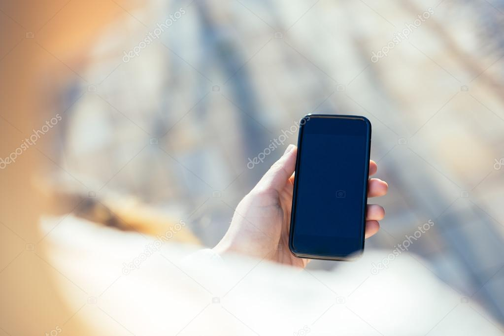 Close up of women's hands holding cell telephone with blank copy