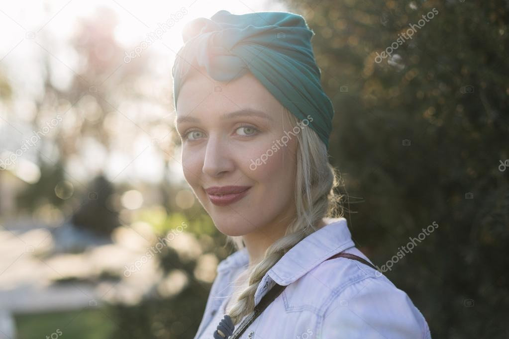 Beautiful sexy young woman blonde hair evening makeup wearing sh