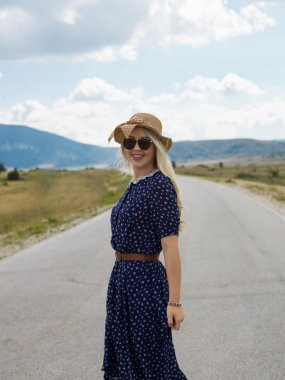 Hippie woman on the road
