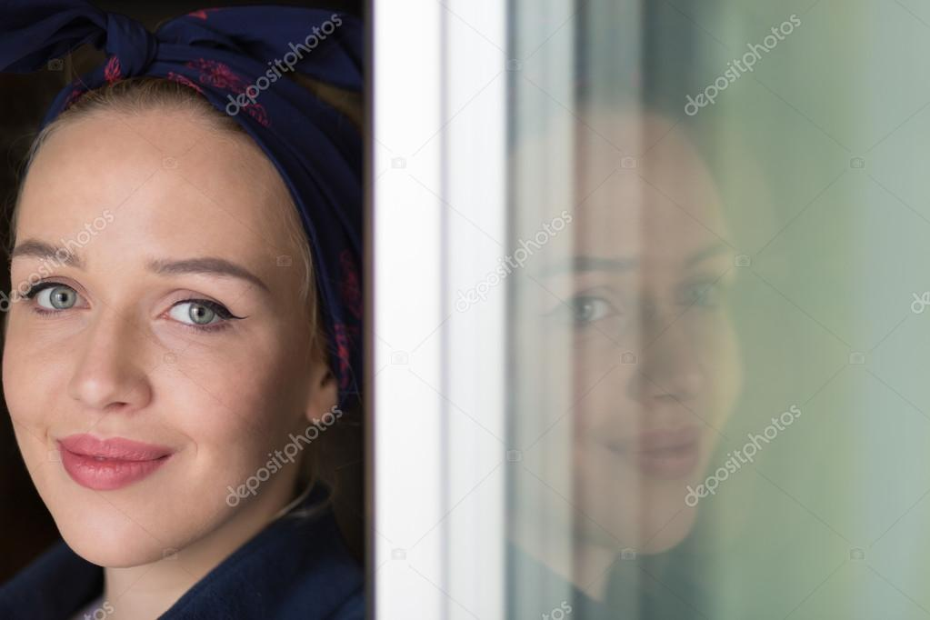 portrait of young business woman at modern startup office interi