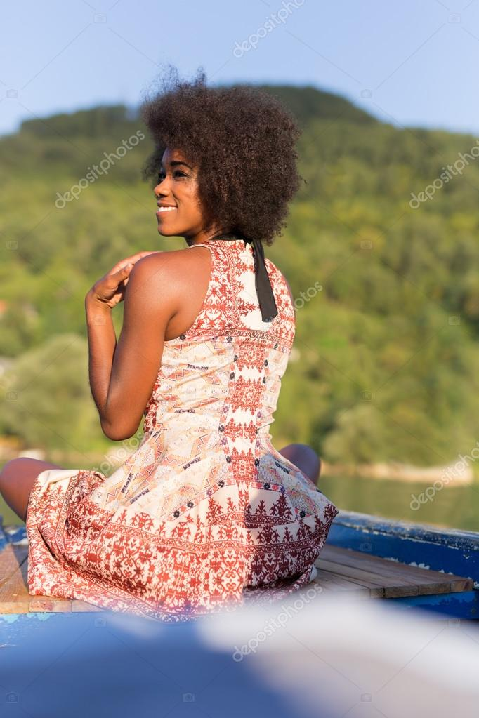 woman on old fishing boat posing