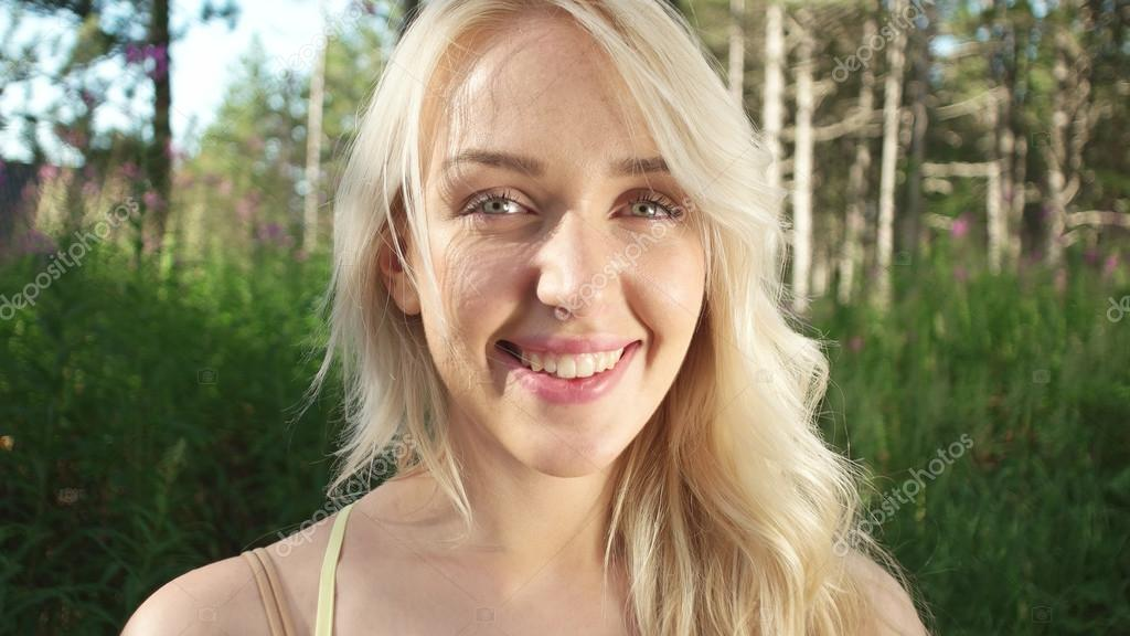 Beautiful blonde girl in nature