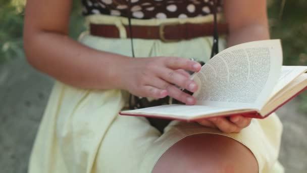 Girl reading book outside
