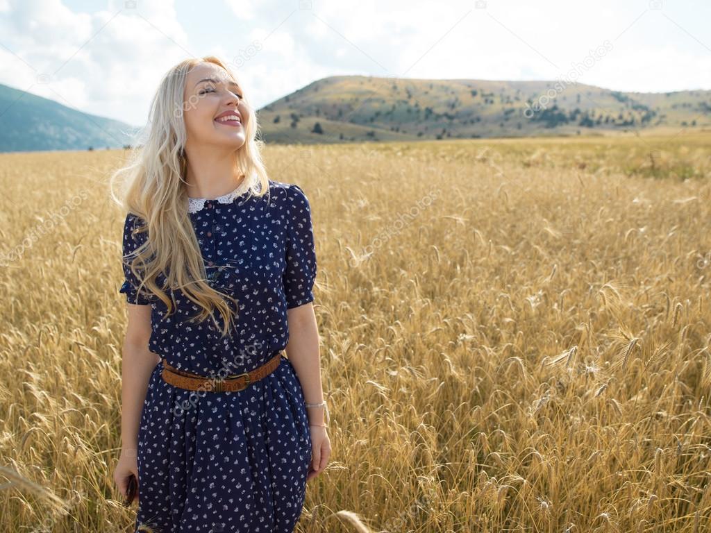 Romantic girl in a field