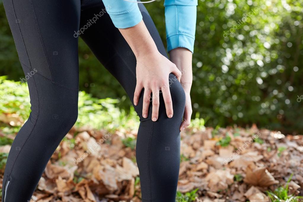 Knee Injury - sports running knee injuries on woman. Male runner