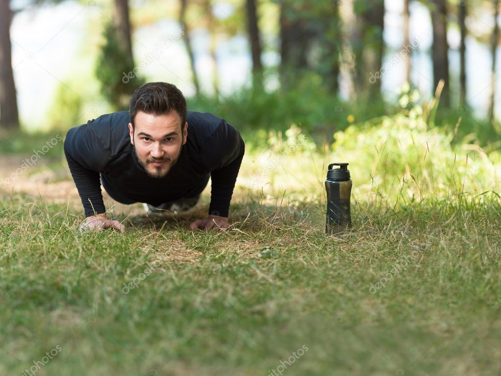 Push ups sport fitness man doing push-ups. Male athlete exercisi