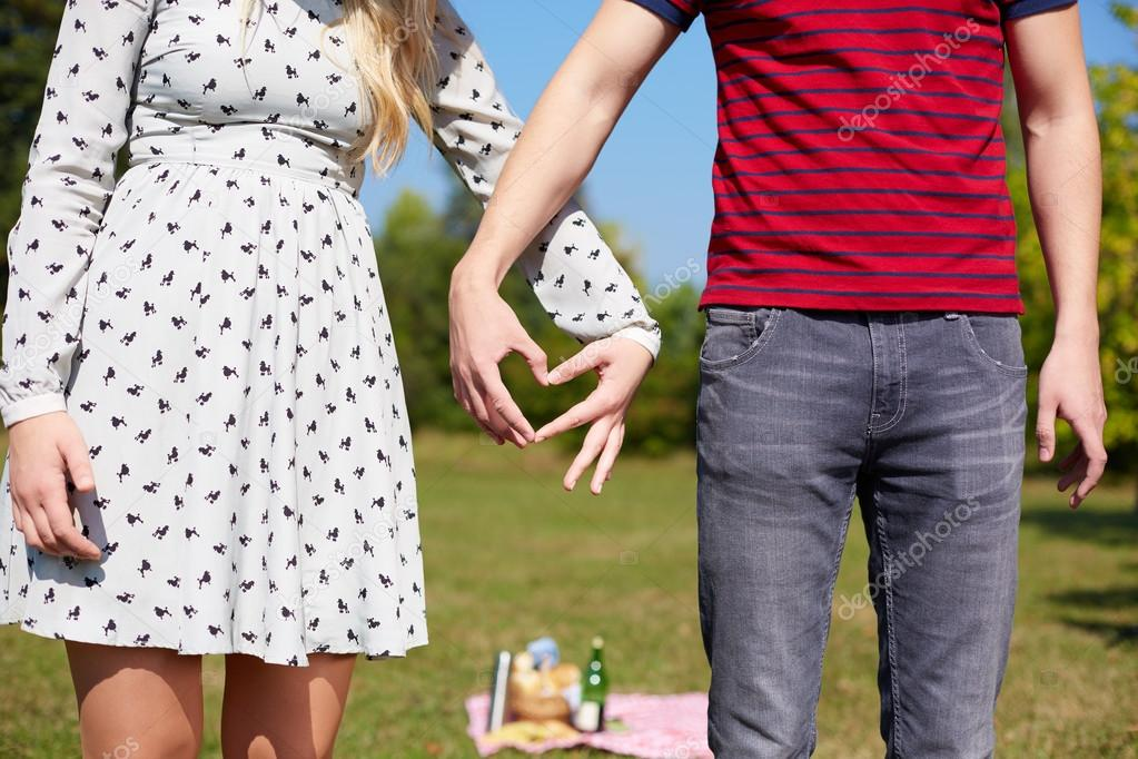 Valentines couple make heart shape with hands