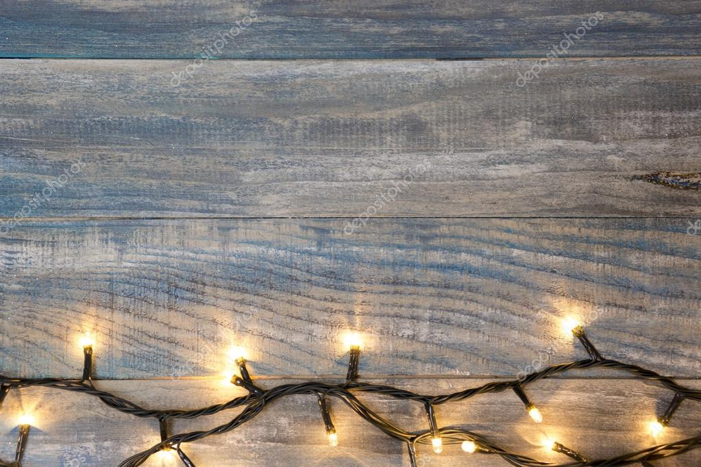 Christmas background. planked wood with lights and free text spa