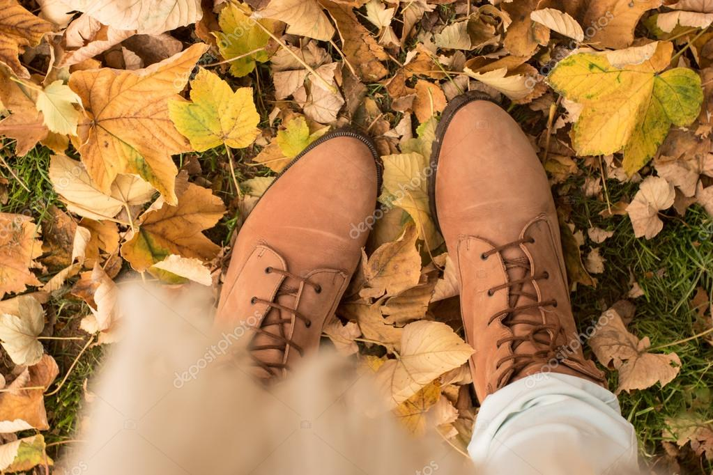 Fall, autumn, leaves, legs and shoes. Conceptual image of legs i