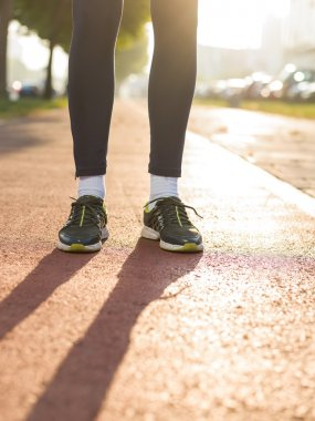 Unrecognizable man with athletic pair of legs going for jog or r
