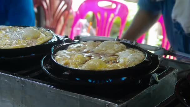 oysters fried in egg batter at water market