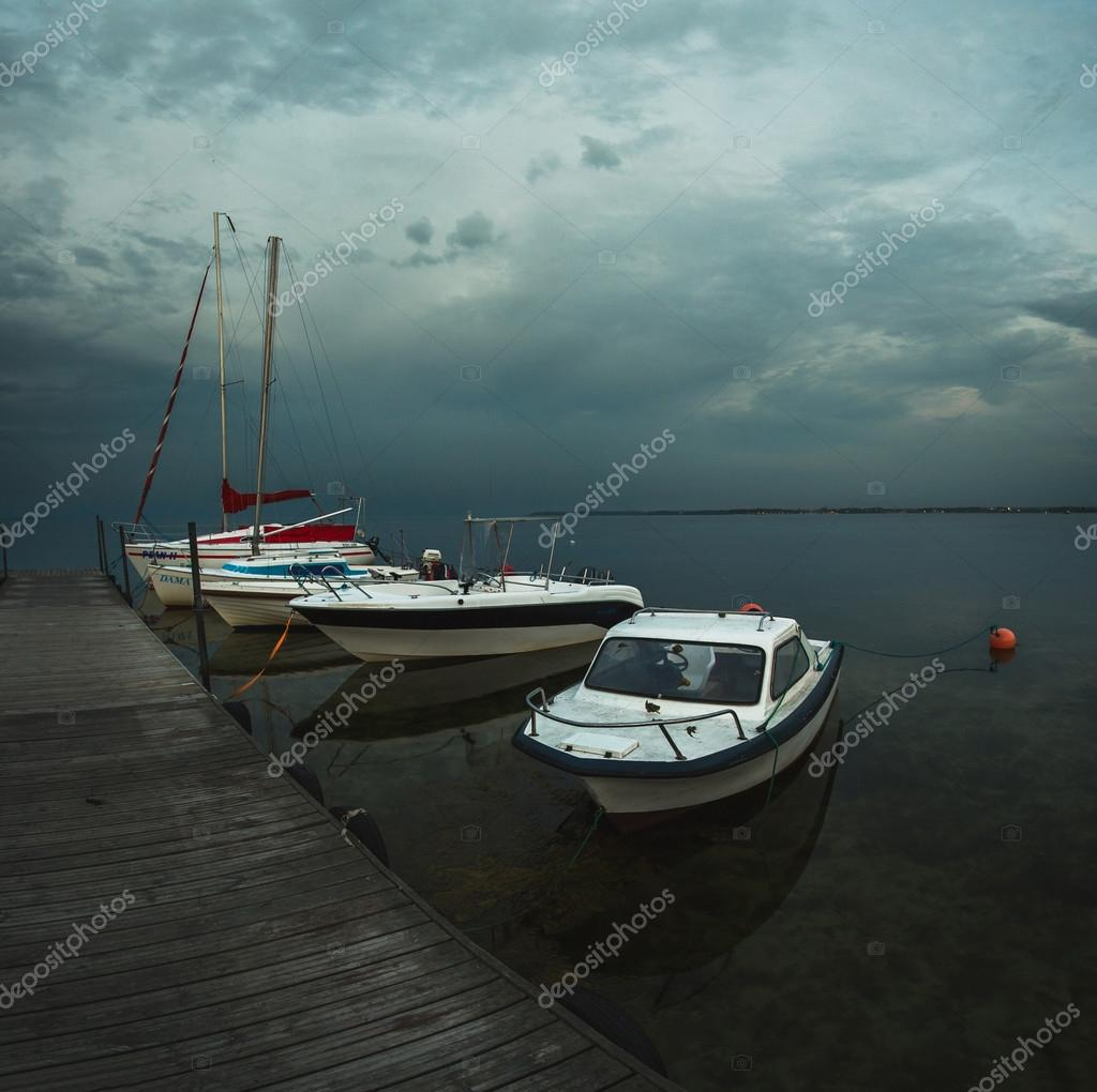 Boats at the dock sunset, cloudy