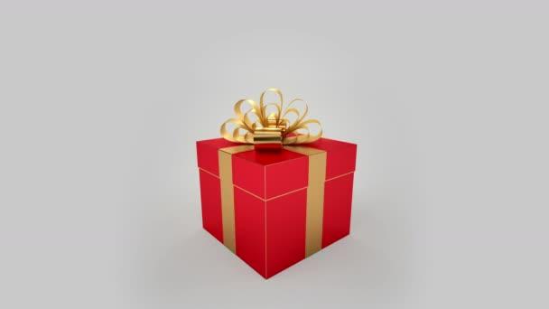 červená dárková krabička s otevřením zlatý luk