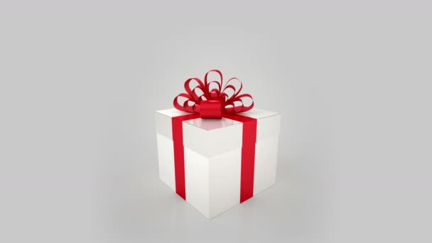 white gift box with red bow opening