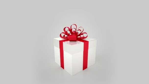 weiße Geschenkbox mit roten Bogen-Eröffnung