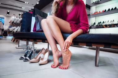 A girl is choosing shoes