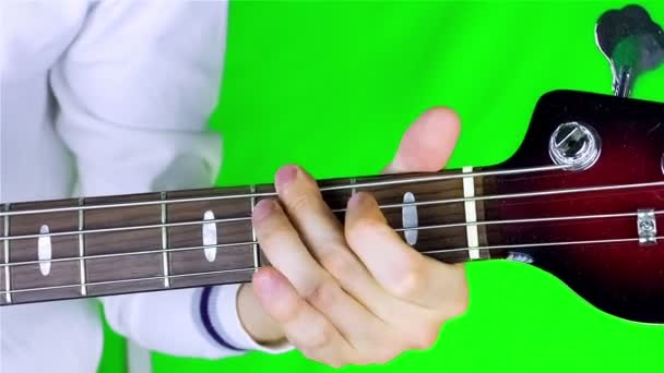 Man playing bass guitar.