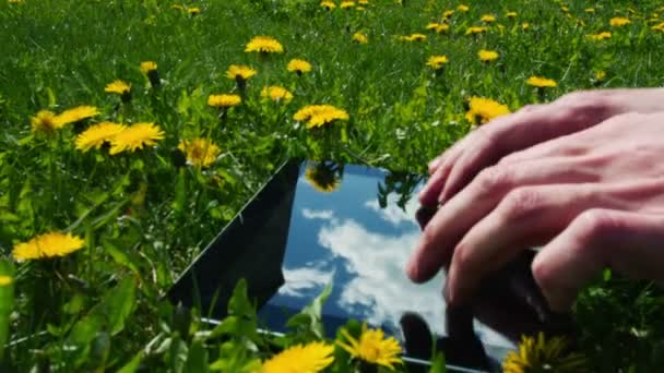 Man using tablet pc outdoors