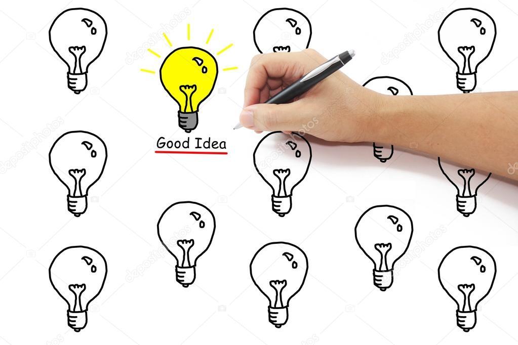 main avec stylo ampoule jaune avec la bonne id e de dessin. Black Bedroom Furniture Sets. Home Design Ideas