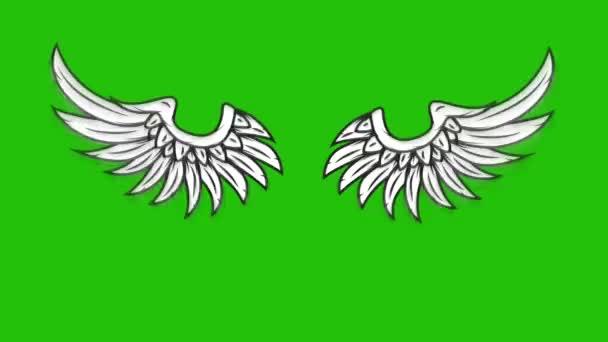 Animace létajících křídel na zeleném pozadí. Animace andělských křídel.