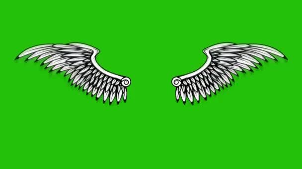 Animáció repülő szárnyak zöld háttérrel. Angyal szárnyak animáció.