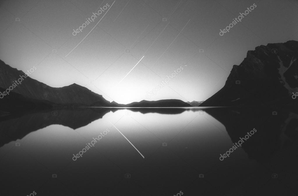 shooting stars over the mountain lake