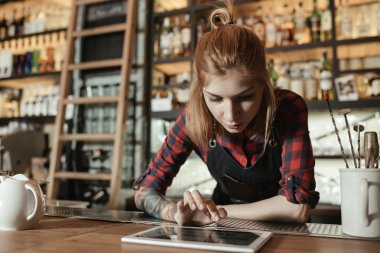 Barista woman with tablet pc