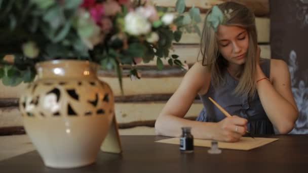 Woman write a letter using antique pen