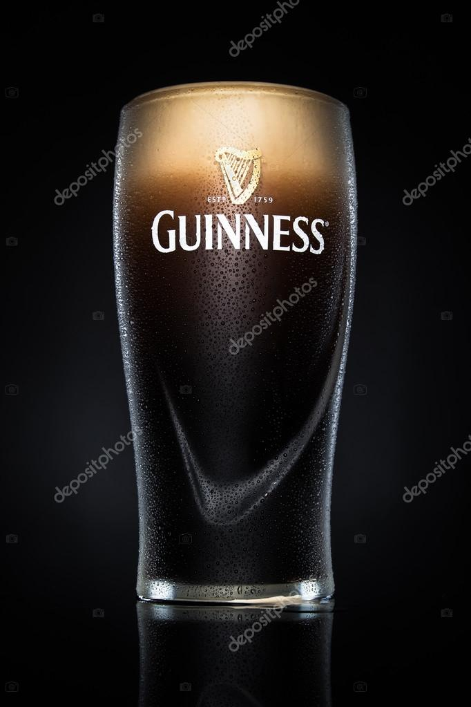 Pint of Guinness, the popular Irish beer on a black background.
