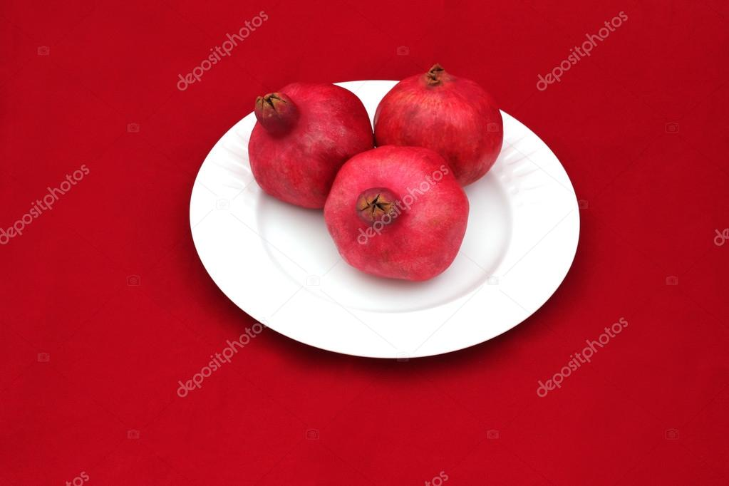 Three Pomegranates On A White Plate Symbol Of Jewish New Year