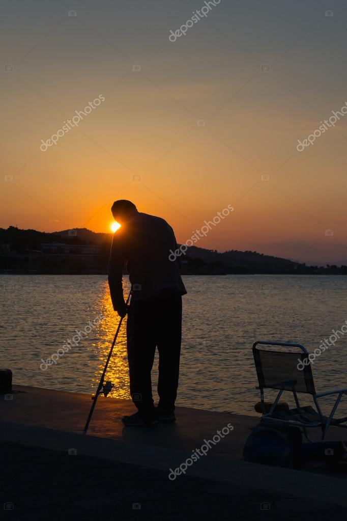 Fisherman silhouette against the sunset.