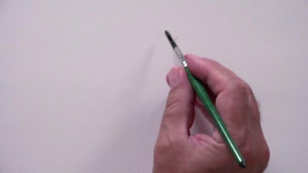 Lidská ruka kreslení nešťastný obličej s černým inkoustem