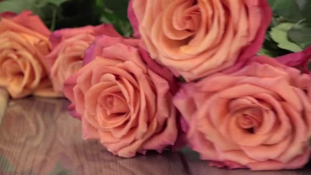 a florist manufactures a bouquet of roses