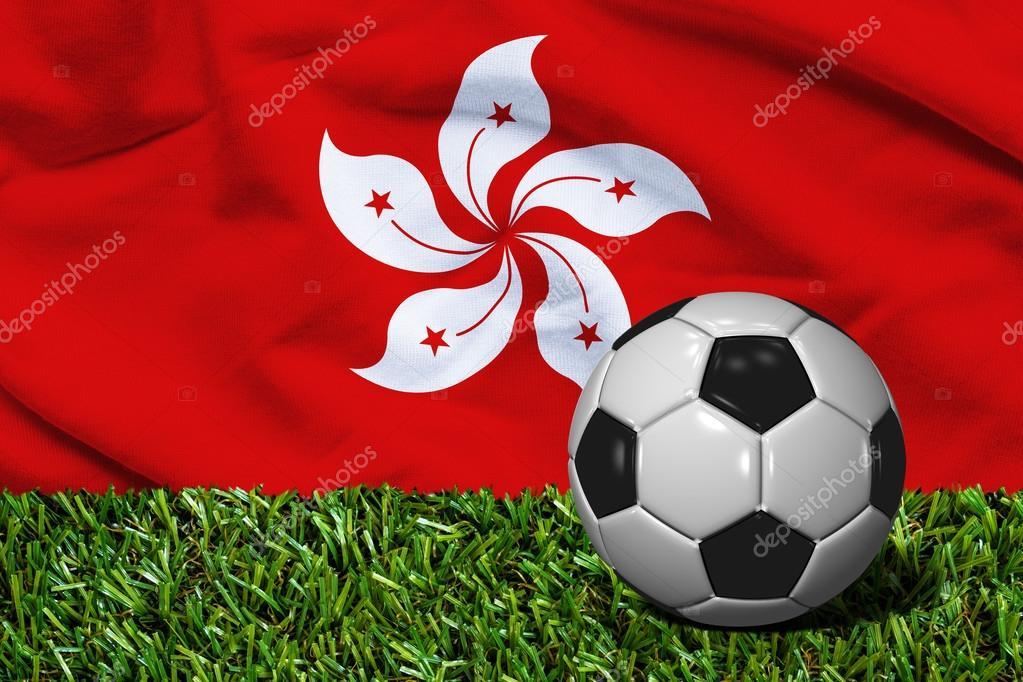 Фотообои Футбольный мяч на траве с Гонконга флаг фоне, 3D визуализации