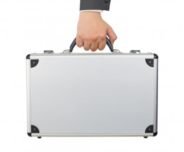 Hand and arm holding silver luggage or brief case isolated on wh